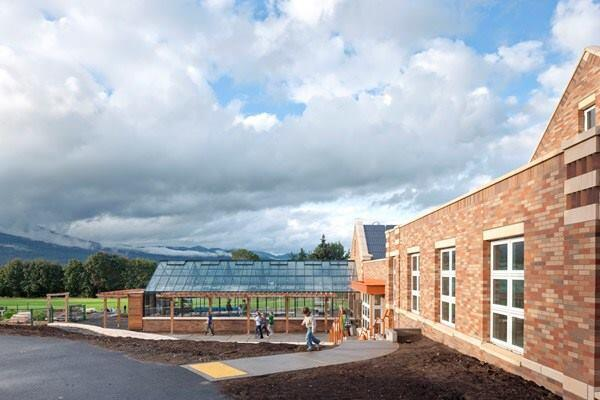 The net-zero-energy Hood River (Ore.) Middle School Music and Science Building, designed by Opsis Architecture in Portland, Ore., was a 2012 AIA COTE Top Ten Project. Its construction includes salvaged materials and it features an educational greenhouse and outdoor garden.