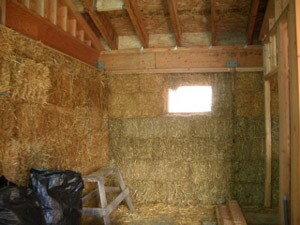 The interior of a Lopez Island house during straw bale installation.