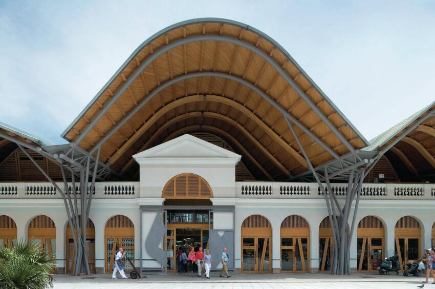 Wrap: Santa Caterina Market in Barcelona, designed by Enric Miralles & Benedetta Tagliabue Architects, reused part of the existing 1848 market building and enclosed the structure with a distinctive and colorful roof.