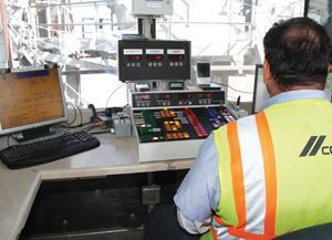 Batchman Chuck Scott monitors the controls at the Cemex batch plant in Sloan, Nev.