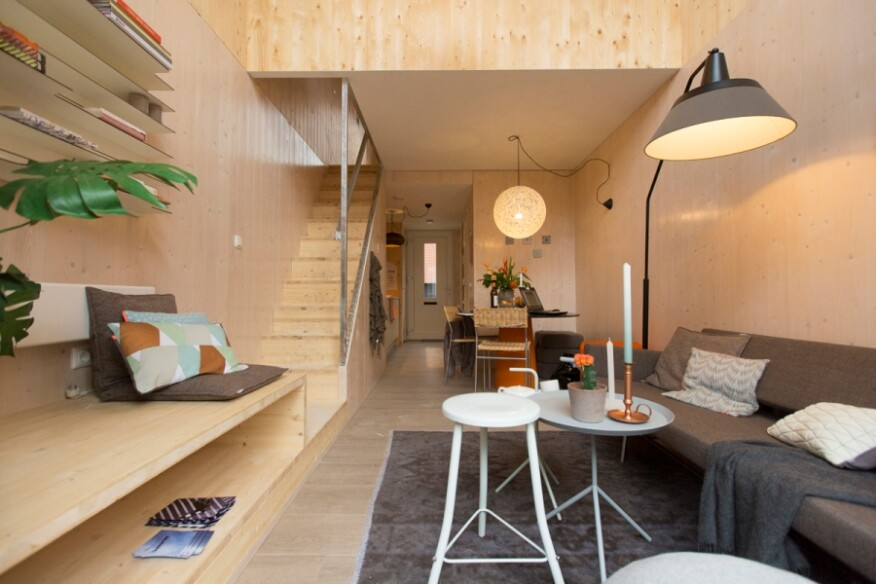 The home's interior uses natural materials and light colors to create a sense of space.