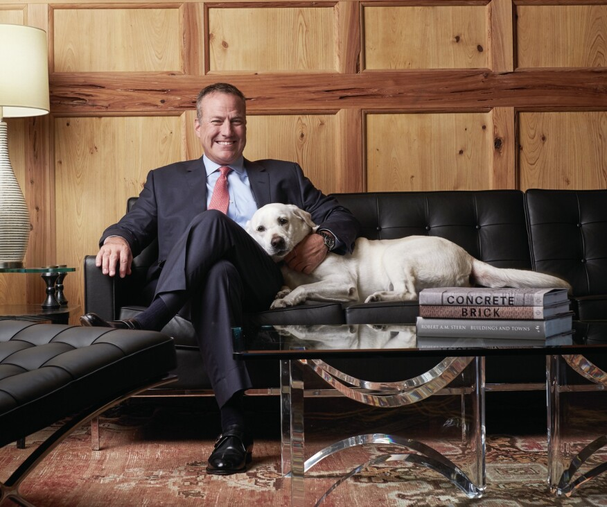 Corporate companion: Among his many down-to-earth qualities, Bob Faith brings his dog, Dakota, to work every day, a cuddly fixture at corporate headquarters.
