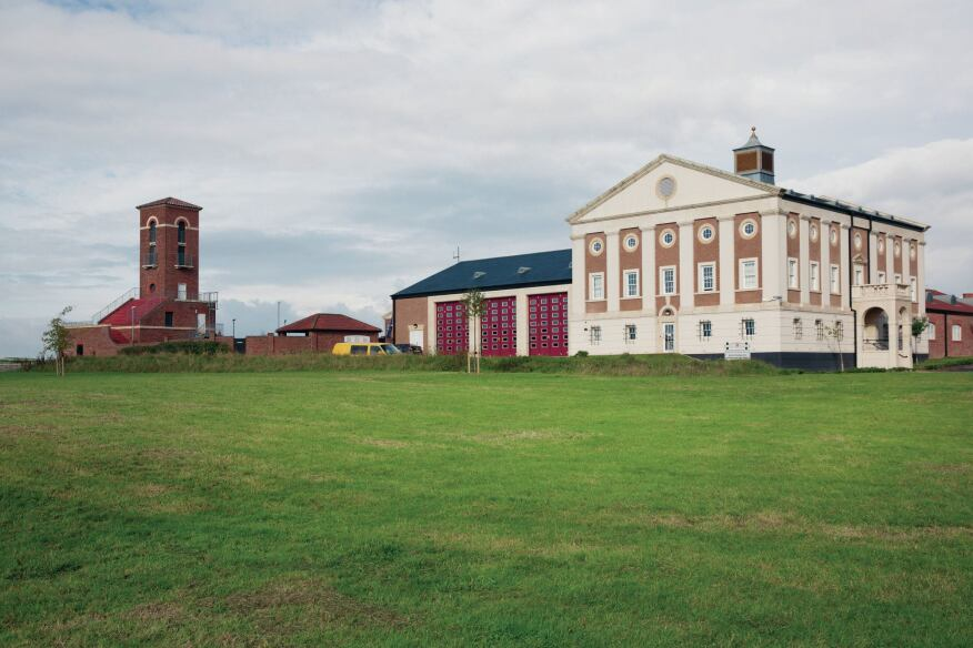 The Poundbury fire station, designed by Calderpeel Architects, is one of the more heavy-handed examples of the town's architecture.
