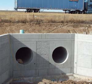 Split-face conditions on the lower and upper quadrants of a stormwater tunnel alignment prompted a Colorado public works department to specify tunneling, which could save the department $750,000 to $1 million. Photos: CTL Thompson