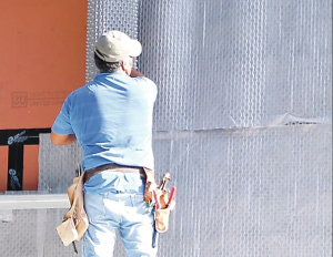 Reservoir cladding like stucco, stone, or brick soaks up lots of water. Stapled to the housewrap, Delta-Dry Stucco & Stone, a dimpled, zero-perm plastic mat, provides an air gap between it and the sheathing and between it and the cladding.