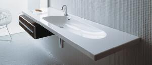 Swiss manufacturer LAUFEN's new Palomba Collection by Italian designers Ludovica and Roberto Palomba draws inspiration from the sea, blending the organic with the contemporary. The line includes wall-hung and traditional toilets, bidets, basins, bathtubs, and furniture. Shown here are the 63-inch lagoon-shaped basin and a console in a macassar finish. LAUFEN USA, 866.696.2493;  www.laufen.com/usa
