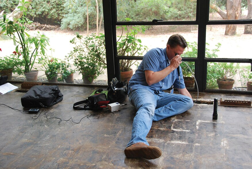 GCI laboratory manager David Carson conductinga heating duct investigation in the Eames House