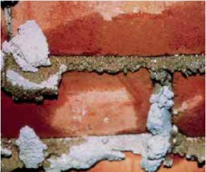 Since winddriven rain may penetrate brick veneer, it is best to assume that the backs of the bricks will be wet. Unless the water can drain to the exterior, moisture can damage framing or interior finishes.