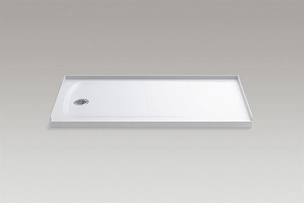 "Keeping a low profile can be a good thing. Constructed with a concrete core and an acrylic surface finish, the Ballast shower base by Kohler has a threshold that ranges from 1-5/8"" to 3-7/32"" tall. The short stature helps users to enter and exit easily, while creating a streamlined transition with surrounding floor finishes. The base requires less maintenance than a tiled shower floor and has less risk of leaking, according to the manufacturer. kohler.com"