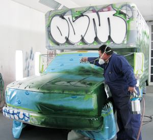 Scott Thompson, automotive painter for San Francisco's Central Shops, works on one of the five graffiti-ridden trucks that public works has repainted. Photos: San Francisco Department of Public Works