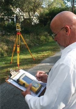 Using a Topcon FC-200 field controller, Gainesville (Fla.) Regional Utiliies Survey Supervisor Jack Goff enters data that will later be downloaded and output to a land-based map.