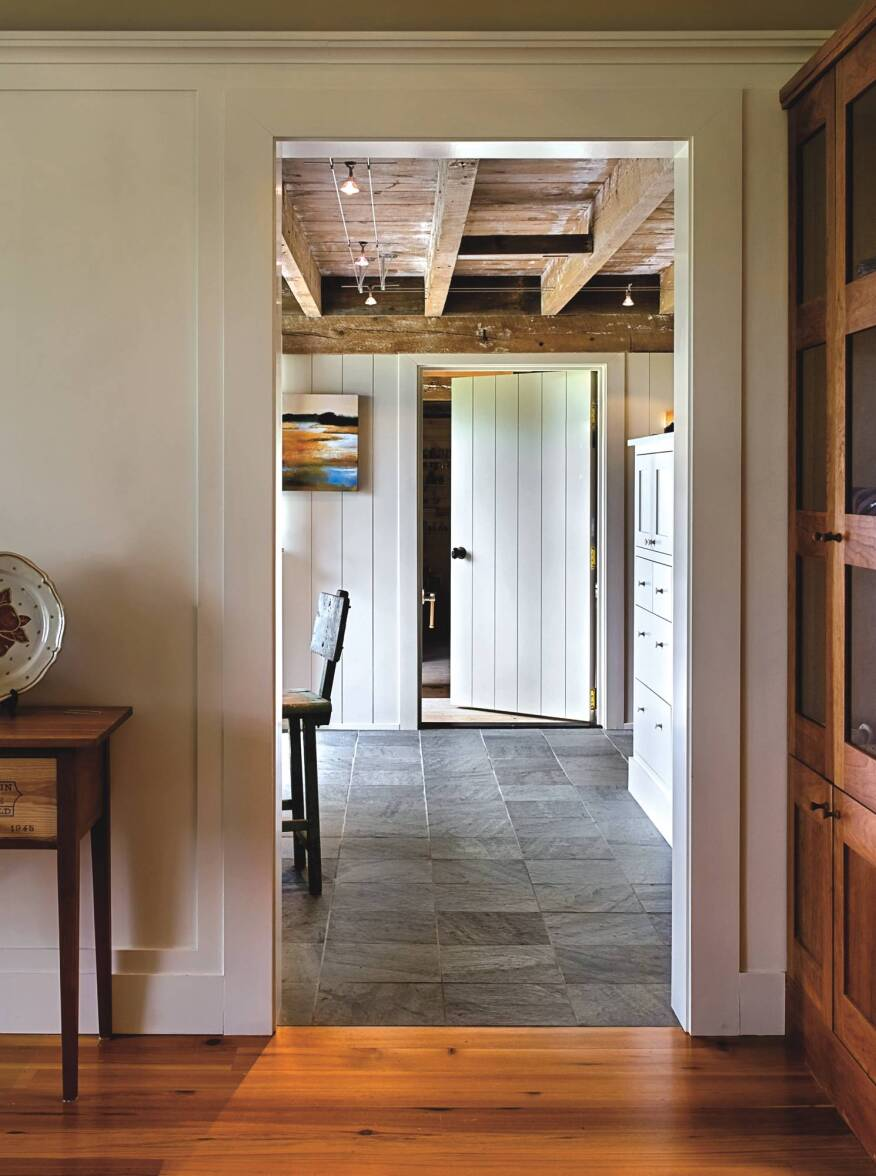 Wide doorways with zero thresholds meld seamlessly with the traditional architecture.