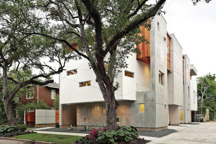 Two trees were saved allowing shade for second-floor patios.