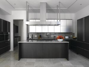 """Abbaka's slim Uni-Form range hood has a 6""""-tall canopy that houses an exhaust ventilator available in 800, 1,000, 1,200, and 1,400 cubic feet per minute power options. The hood comes in seven standard sizes, from 42"""" to 78"""" wide, with custom sizes also available. An in-hood commercial baffle filter system meets the demands of restaurant-grade ranges, while a variable-speed fan provides control, and mini halogen lamps offer task lighting. Available in wall-mount or island versions.abbaka.com"""