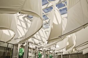 "Two L-shaped building masses surround a central atrium that brings natural light deep into the nine-story office space and provides a gathering space for EPA employees and the public. Innovative parabolic canvas reflector ""sails"" at the top of the atrium direct and buffer the light to prevent glare. The sails were fabricated from the same type of canvas used in boat sails."