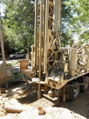 The geothermal installers attempted to drill boreholes for two days, but the silt and water impeded the process.