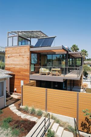"The multiple decks and terraces of architect Ray Kappe's ""exploded box"" design expand living space by extending it outdoors. Drought-resistant native plantings add vibrancy while requiring little water or maintenance."