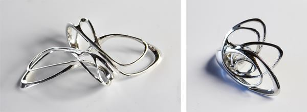 Wu's Mobius rings can be paired (left) and are each offered in dimensions of 1.4 inches long and wide and 1.7 inches long and wide. The Papilio ring (right) measures 1.8 inches wide and 1.7 inches long.