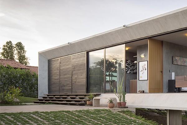LaCantina Doors, contemporary clad, anodized bronze exterior cladding, bronze door cladding, lift-slide door, folding door, indoor-outdoor living