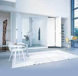 Dornbracht's Solitude shower system features a freestanding oval column with a shower system on one side and a sink, faucet, mirror, accessories, and integrated lighting on the other. The two sides are separated by pivoting glass panels. www.dornbracht.com