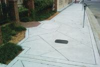 Sidewalk repairs combine ADA upgrades with decorative elements