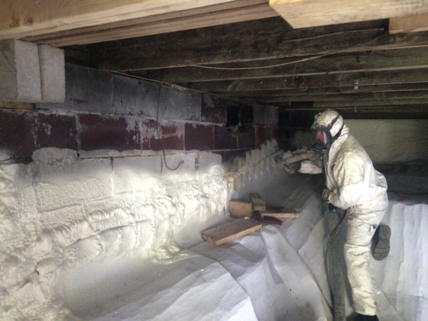Spray foam in the basement cut the heat loss to the ground, as well as limiting the building's vapor load. A foam application sealed the ground vapor barrier to the wall.
