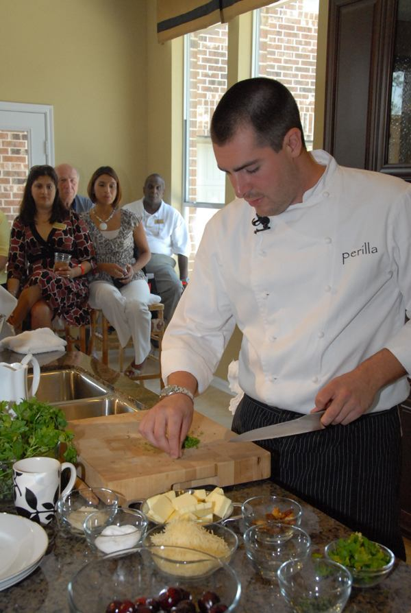 Chef Harold Dieterle gives a cooking demonstration for Houston-area Realtors in a Beazer Homes model home.
