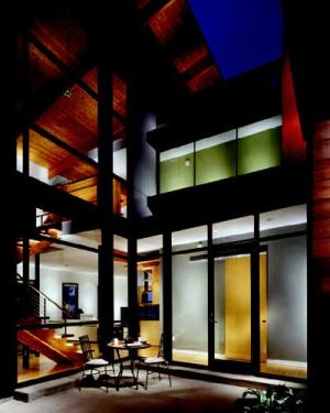WINDOW DISPLAY: Custom glazing was this home's big-ticket item. An intimate courtyard facing  south blurs the boundaries between indoors and outdoors with large expanses  of low-E glass.