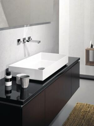 "The Metaphor basin from Alape has thin but sturdy walls and a sleek, cubic silhouette. At 4"" tall and 14 3/4"" deep, the surface-mount, glassed-steel basin is available in three widths—39 3/8"", 29 1/2"", and 19 3/4""—with optional towel bars. alape.com"