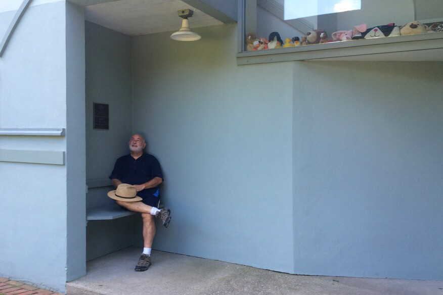 Lockard in front of his new house