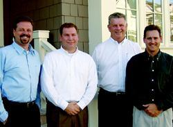 BUILDERS: The David Weekley Homes team, from left to right: Bill Wood, on-site project manager; Ken McDonald, Orlando division president; Randy Braden, Florida area president; Ted Brock, Baldwin Park project manager