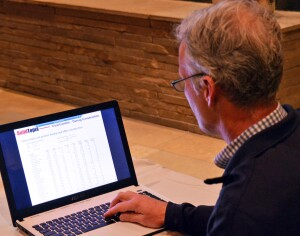 Alan Banks, marketing director for Evans Coghill, shows off the company's new software system.