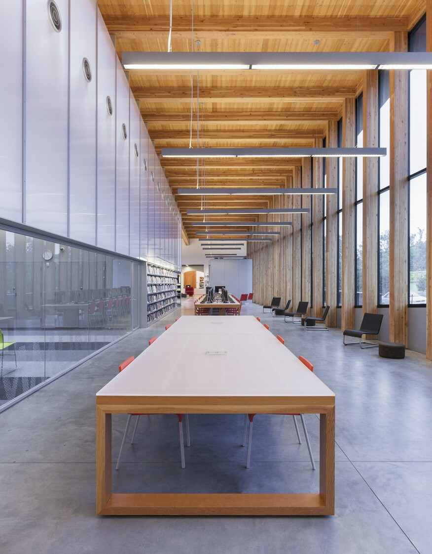 Suspended table by berstein architects - The Duo Of Natural And Electric Light Create An Open Airy Feeling In The Main