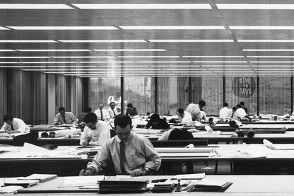 An archival photograph shows an interior of the Inland Steel Building not long after it was completed in the 1950s.