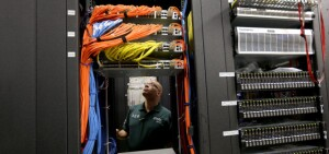 POMPANO BEACH, FL - FEBRUARY 13: Warren Myers, a headend manager, stands among the cables and routers at a Comcast distribution center where the Comcast regional video, high speed data and voice are piped out to customers on February 13, 2014 in Pompano Beach, Florida.  Today, Comcast announced a $45-billion offer for Time Warner Cable.  (Photo by Joe Raedle/Getty Images)