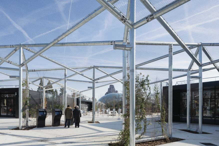 The main entrance to the zoo directs visitors between two new ticketing halls, and underneath a canopy of chain-link panels.