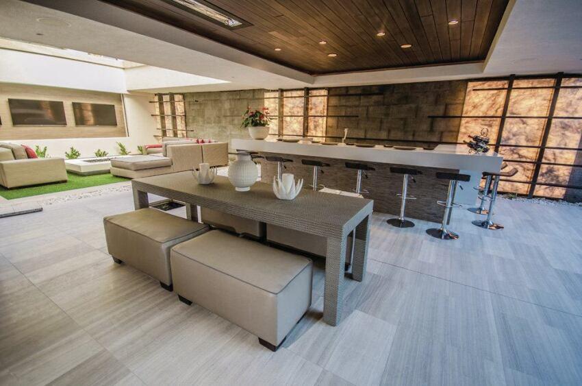 10 outdoor kitchen designs we love builder magazine for Design outdoor kitchen online