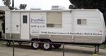 "Parked in clients' driveways, DreamMaker Bath & Kitchen's mobile kitchens ""get  a great response,"" co-owner Patty Gray says."