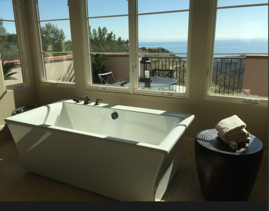 """Her"" master-bath in one of The New Home Company's Coral Crest plans, overlooking Abalone Point on the Newport Coast of California."