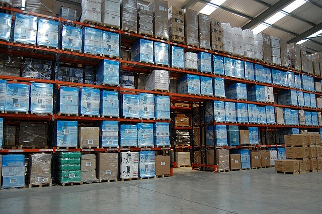 Generic view of a warehouse with unshelved products.