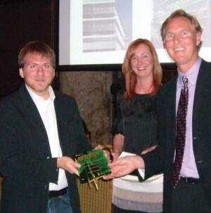 John Reister, Christina Koch, and Award Winner, Myer Harrell