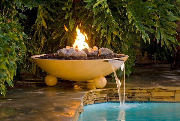 A fire element can add a spark of drama to a poolscape.