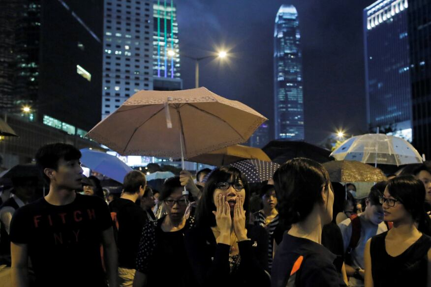 Protester reacts during a rally outside government headquarters in Hong Kong.