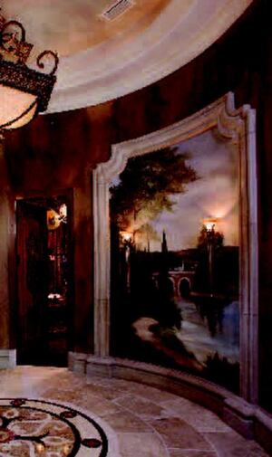 CONCAVE SCENE: Hanging flat art on a curved wall was a non-option in the entry rotunda. As  an alternative, faux artist Ann Telford painted a vignette of Tuscan countryside  directly on the wall. A cultured stone surround frames the mural and  meshes cleanly with the foyer's baseboard detailing.