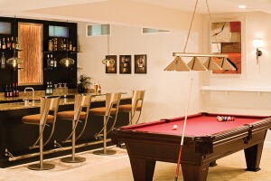 A pool table and bar are but two amenities in this large basement makeover.