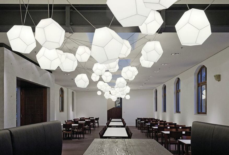 Custom pendants create a sculptural lighting element in the Old Guardhouse, which is now a special events space.