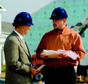 EFFICIENCY EXPORT: Bob Kehlor, C.P. Morgan's executive vice president of housing (left) talks  with John Nichols, the builder's director of construction in Charlotte, N.C., who  applies supply-chain management techniques that are successful for the  builder in its Indianapolis base.