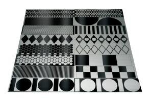 """Lasertrons etched stainless steel backsplashes start as a single piece of mirror-finish stainless steel. During the manufacturing process, pattern outlines are masked and the exposed area is brushed with an abrasive. No toxic chemicals are used. Geometric patterns include squares, circles, and diamonds. Panel sizes can be made up to 48"""" by 96"""". ¢ lasertrondirect.com"""