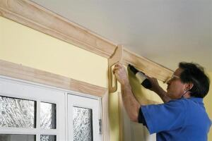 This custom-made jig aligns crown molding consistently during installation, and also helps as a layout tool.