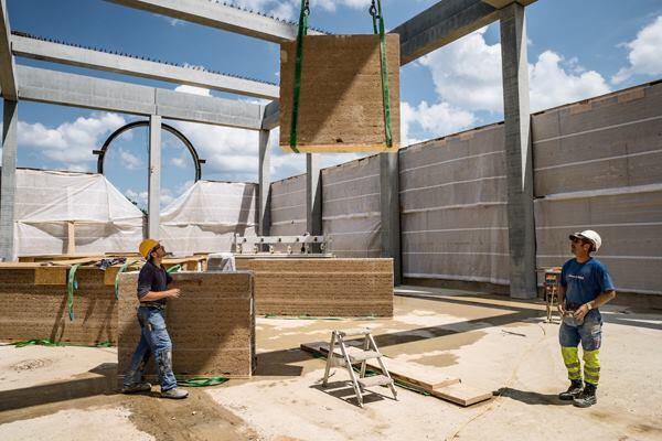 The rammed-earth panels were fabricated off site.